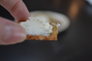 Seedy Sweet Potato Cracker being held